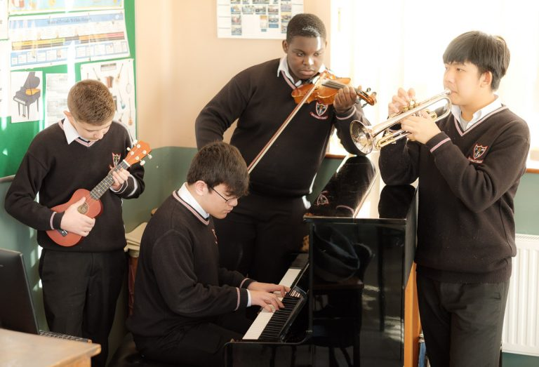 Students from Ennis Community College play music. Photograph by Paul Corey