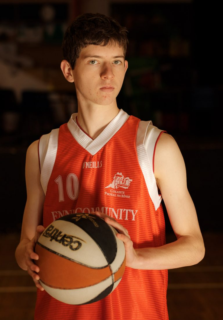 Student from Ennis Community College with basketball. Photograph by Paul Corey