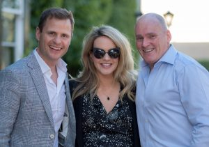 John Burke and Aoibhin Garrihy with Allen Flynn as they enjoy a summers evening at the Jin and Jazz charity event.