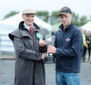 Tom Millicken presenting Kieran Killeen with a trophy for the overall Dairy category at the Mullagh Agricultural Show. Photo by Paul Corey.